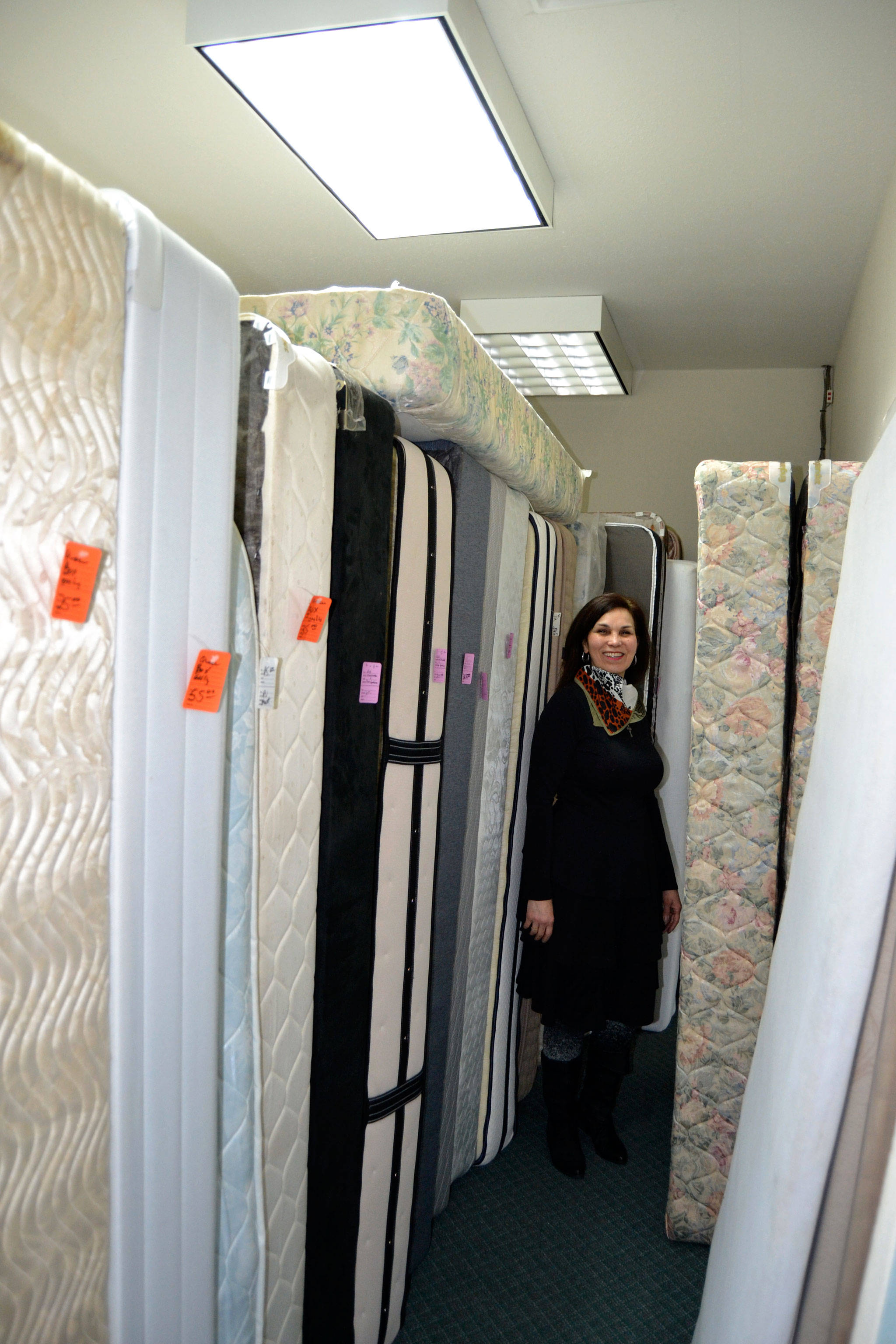 "Mattresses line one of the many rooms in the Designer Furniture Showcase and Bedroom Furniture Annex recently opened by Serenity Thrift Store and orchestrated by store director Belicia ""Belle"" Muñoz. Sequim Gazette photo by Matthew Nash"