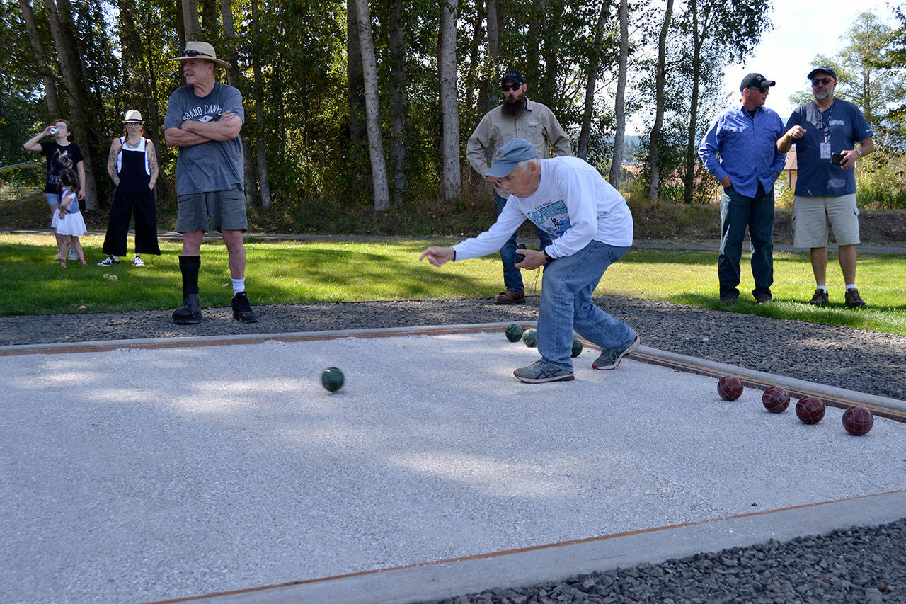 David Stahl rolls a bocce ball to help open play on the new court in Carrie Blake Community Park on Aug. 28. Sequim Gazette photo by Matthew Nash