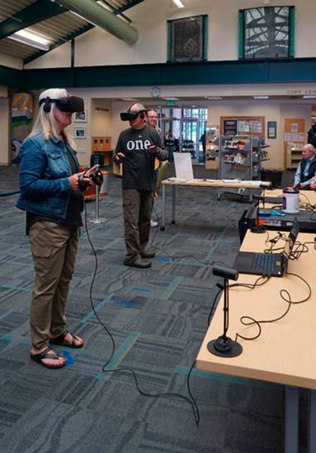 Patrons at the Port Angeles Library try out virtual reality. Multiple events continue in Port Angeles and Sequim for patrons 13 and up to try. Registration is required. Photo courtesy of NOLS