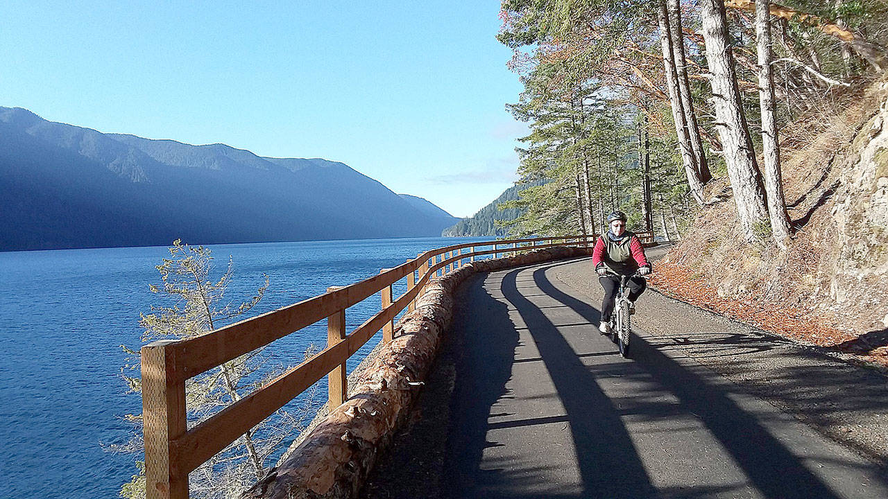Bicyclists and hikers enjoy beautiful weather at the new Spruce Railroad Trail on Dec. 2 on the north shore of Crescent Lake. Here a cyclist rides the trail just west of the Daley Rankin Tunnel. Photo by Pierre LaBossiere/Olympic Peninsula News Group